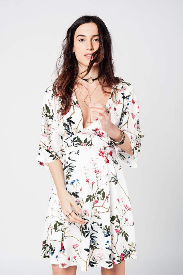 White plunge neck midi dress with wide sleeves and floral print