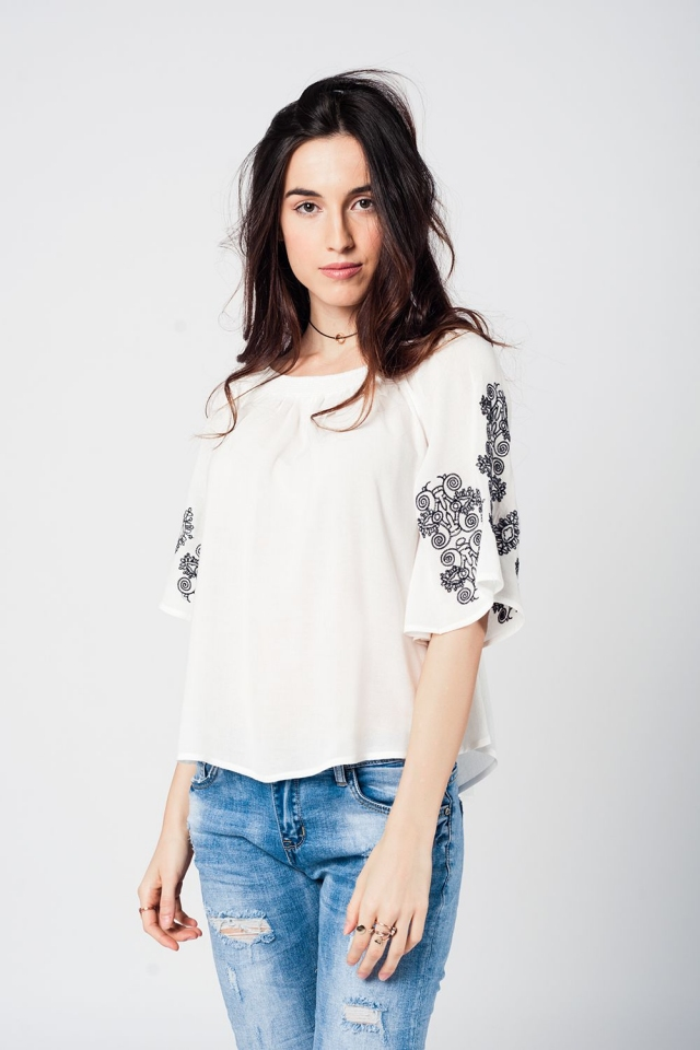 White off shoulder relax short sleeve top with black details
