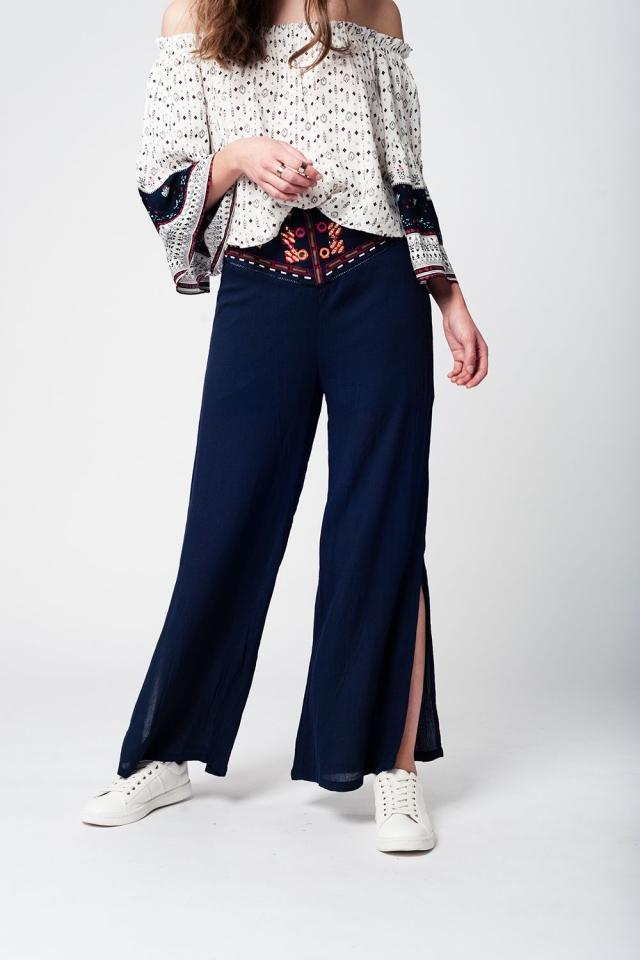 Pantalón navy de pernera ancha y cintura alta con diseño vintage en la cintura