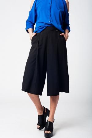 Falda pantalón negro con botones de plata