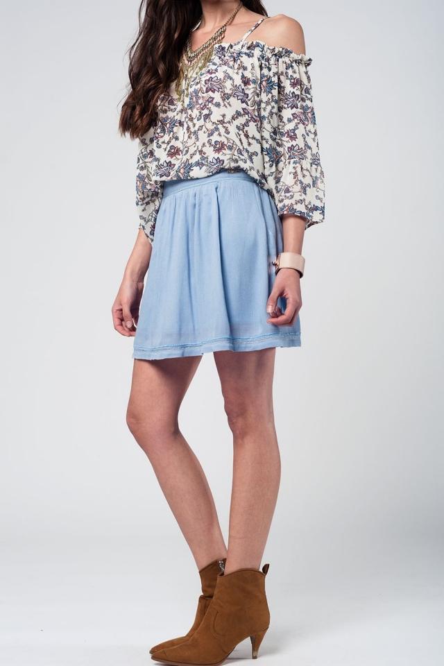 Falda corta azul con bordado azteca