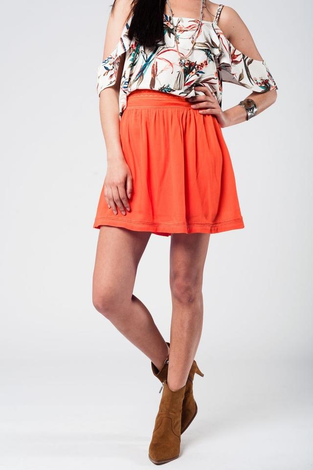 Falda corta naranja con bordado azteca