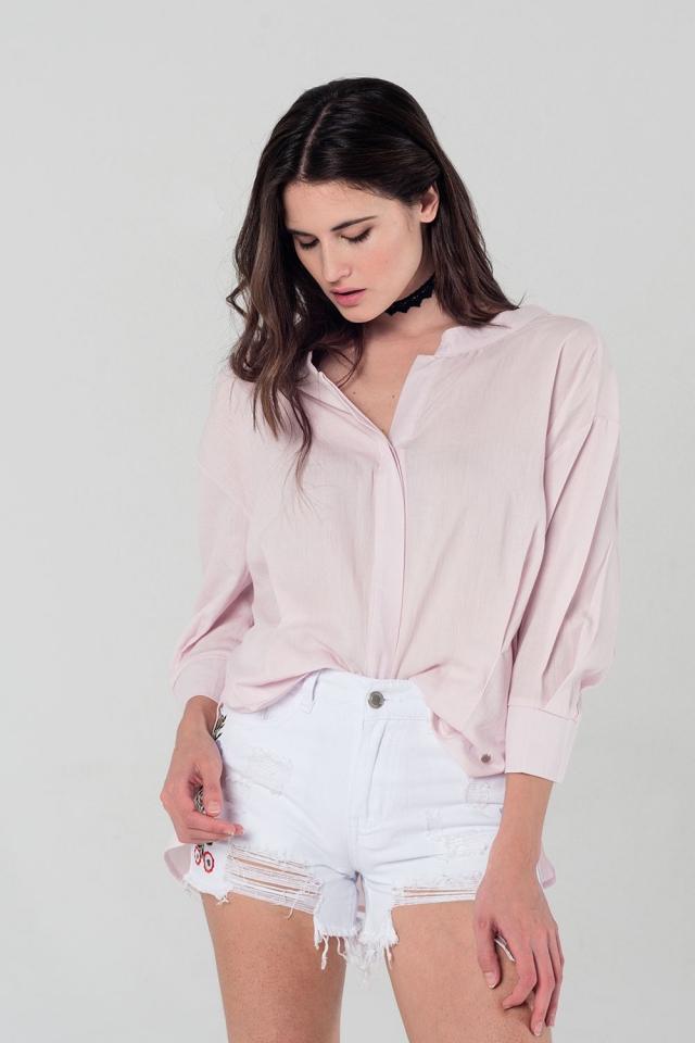 Camisa con detalle de lazada en color rosa