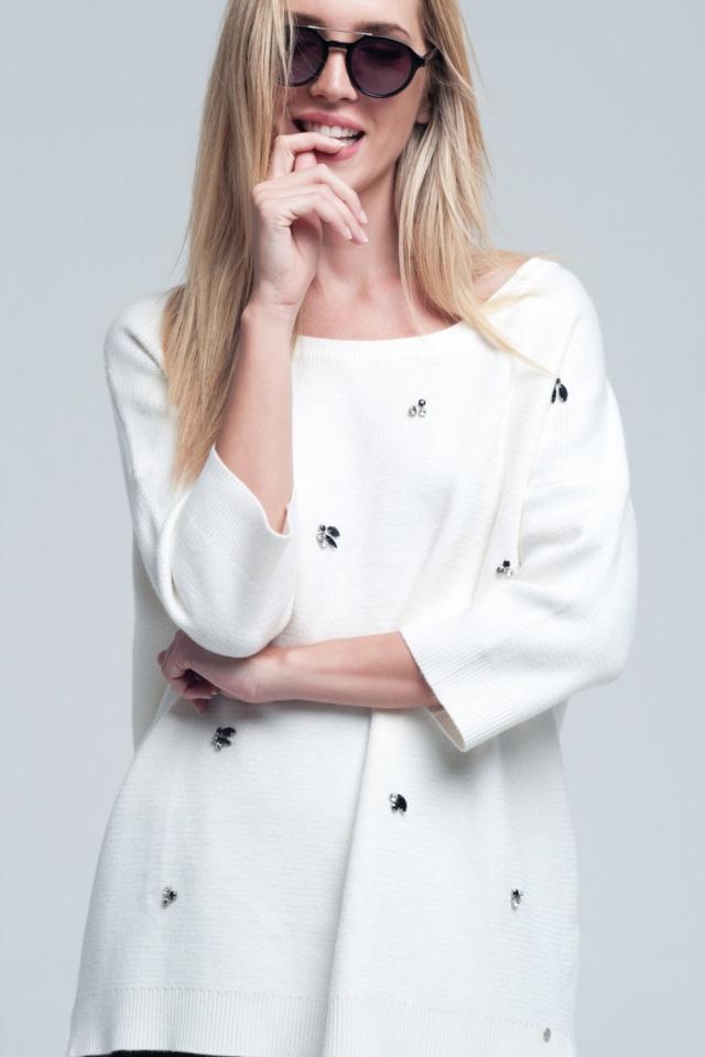 Jersey blanco asimétrico con detalle de strass y espalada desnuda