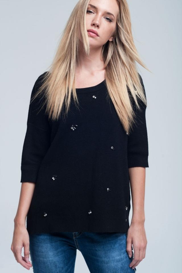 Jersey negro asimétrico con detalle de strass y espalada desnuda