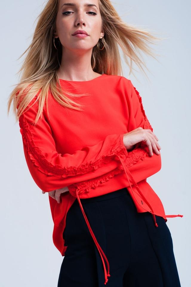 Orange flowing blouse