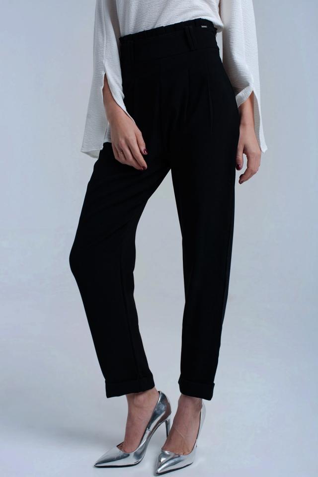 Pantalones negros con volantes