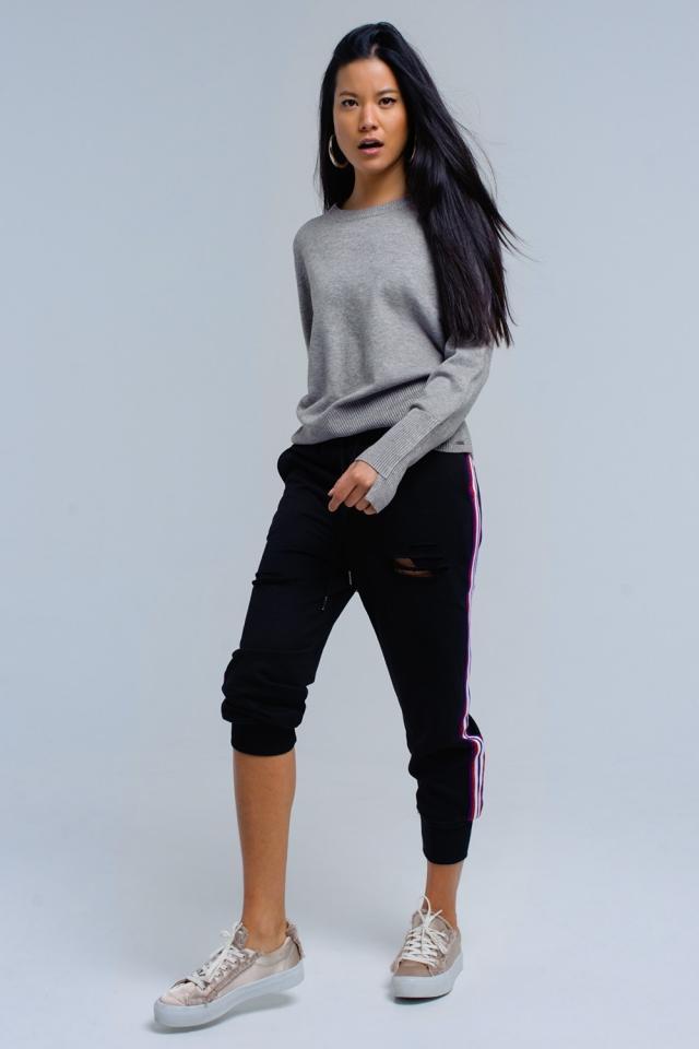 Pantalones negros con rasgaduras