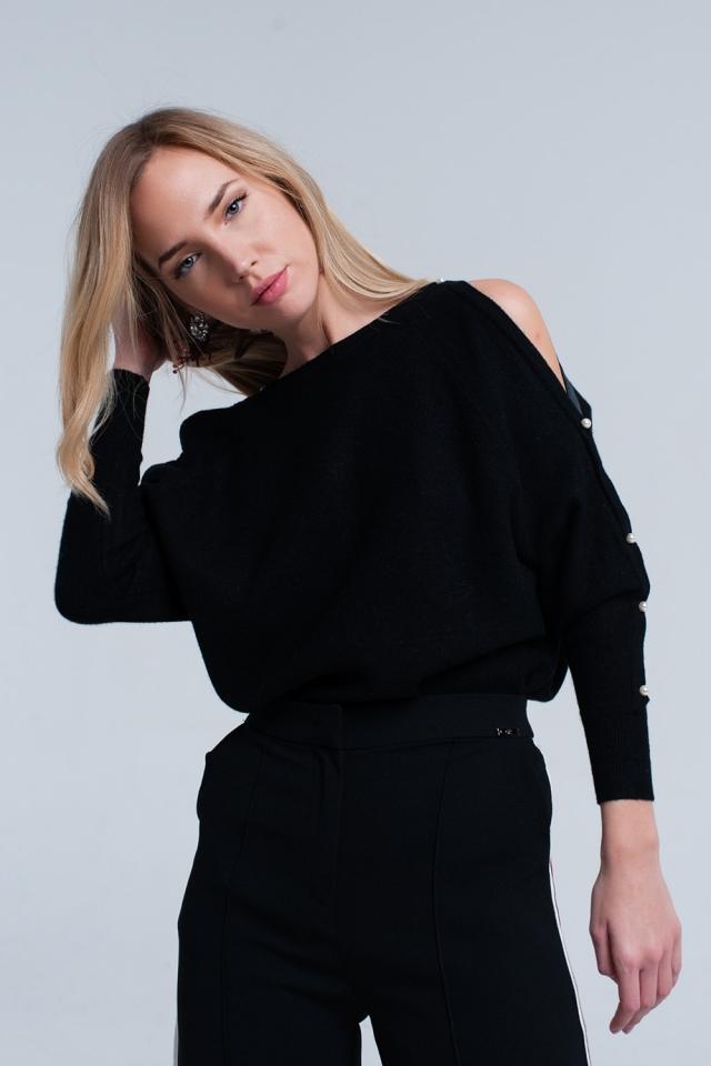 Jersey de punto negro con detalle de perla