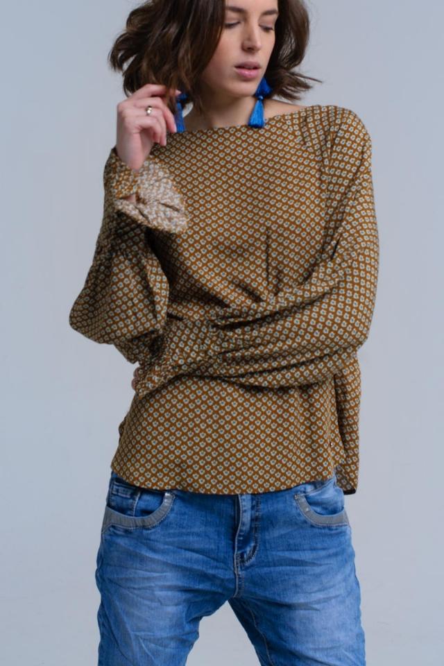 Camisa mostaza estampada con puños con volantes