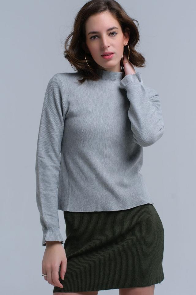 Jersey con volantes en gris