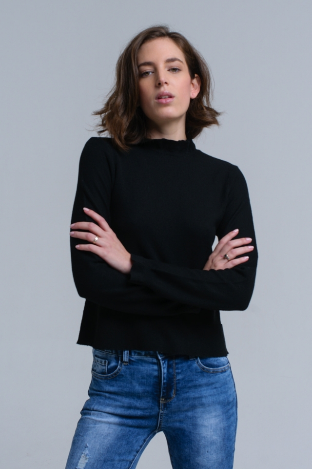 Jersey con volantes en negro