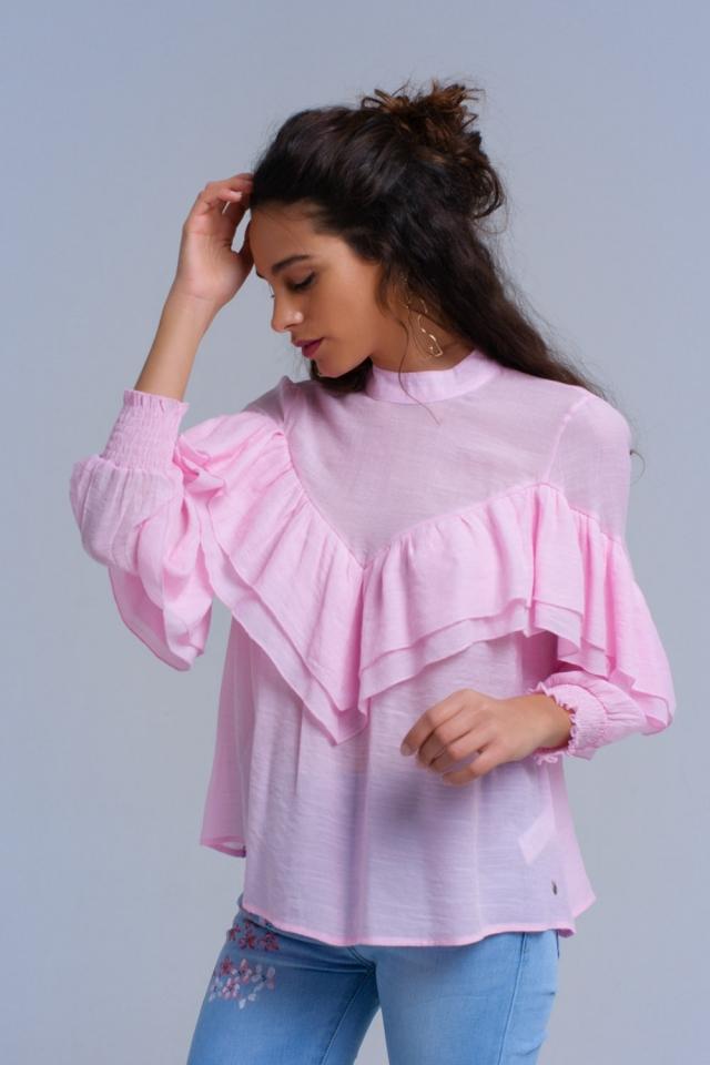 Camisa rosa con volantes y puños elasticos