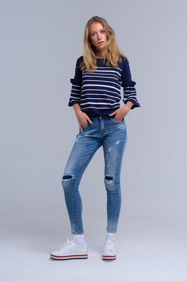 Jeans ajustados con rasgaduras
