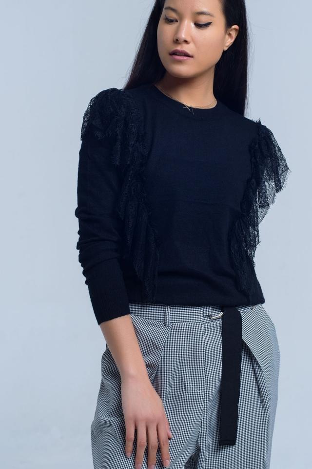 Jersey negro con volantes de ganchillo