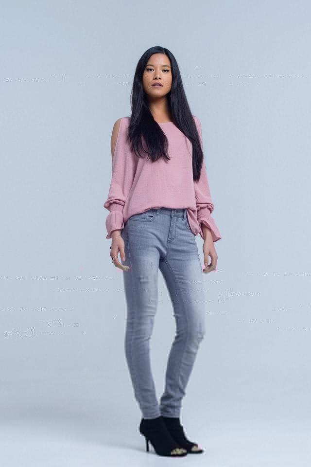 Jeans grises con detalle de rasgaduras