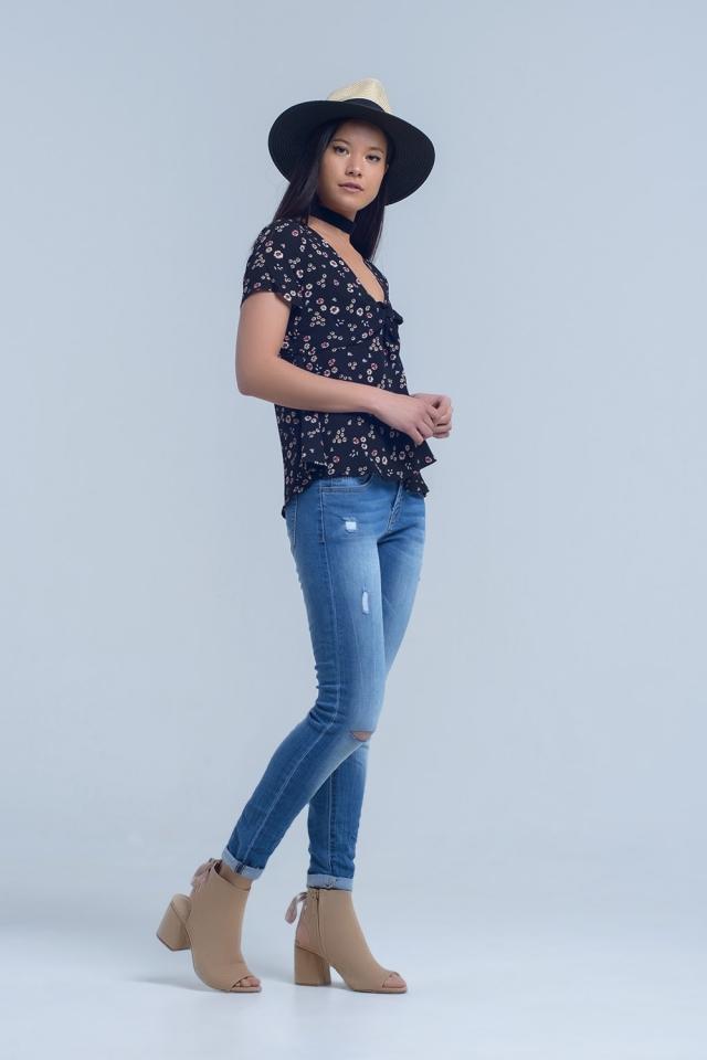 Jeans skinny con rodillas rasgadas