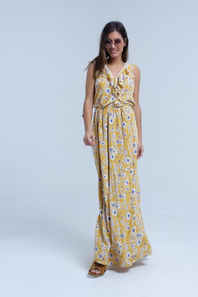 Vestido largo con estampado floral amarillo y detalle de volantes