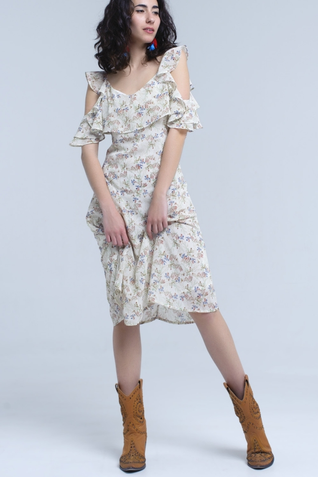 Vestido midi crema con detalles de volantes en estampado floral