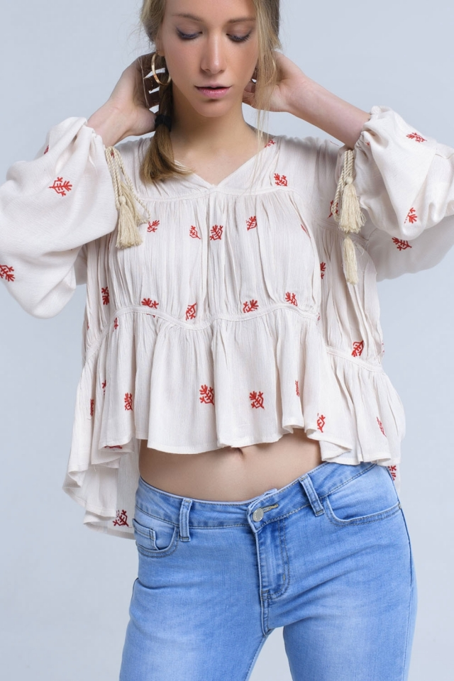 Blusa bordada en color beige con manga ancha