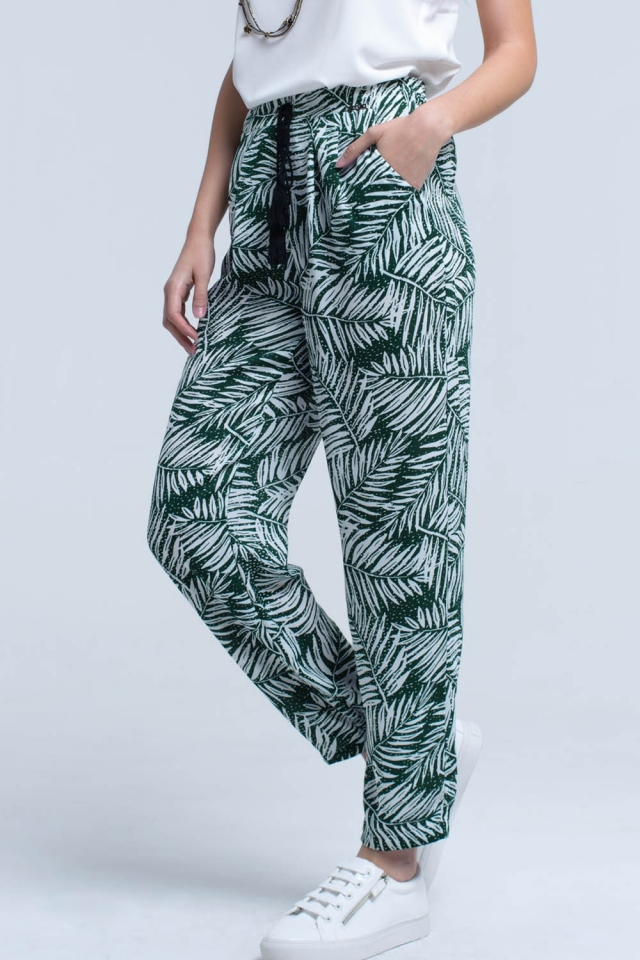 Pantalones verdes con estampado de hojas