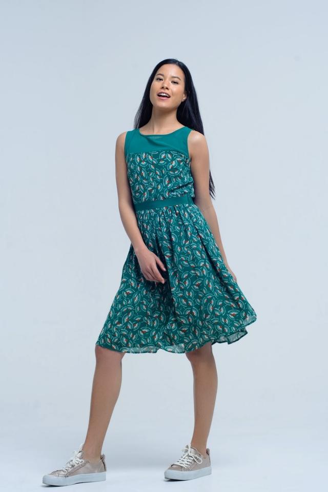 Vestido verde con estampado geométrico con lazo