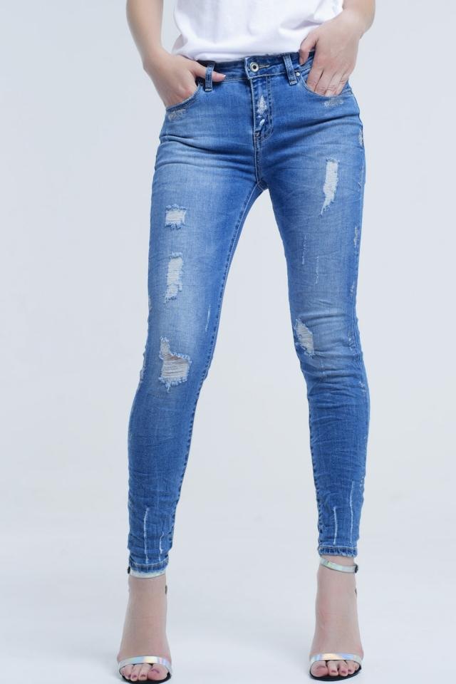 Jeans ajustados con rasgaduras y purpurina