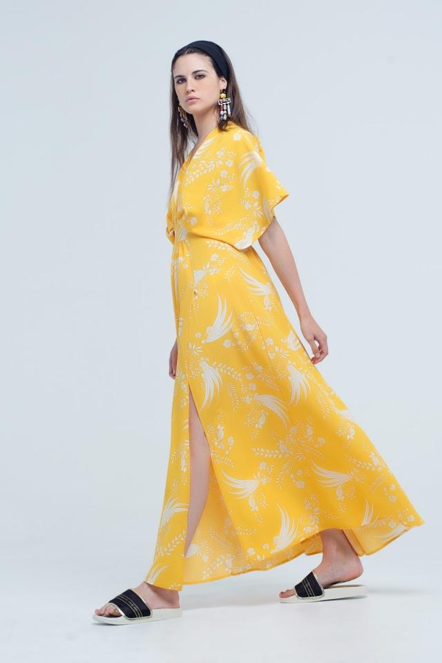 Vestido largo amarillo con flores impresas y aberturas