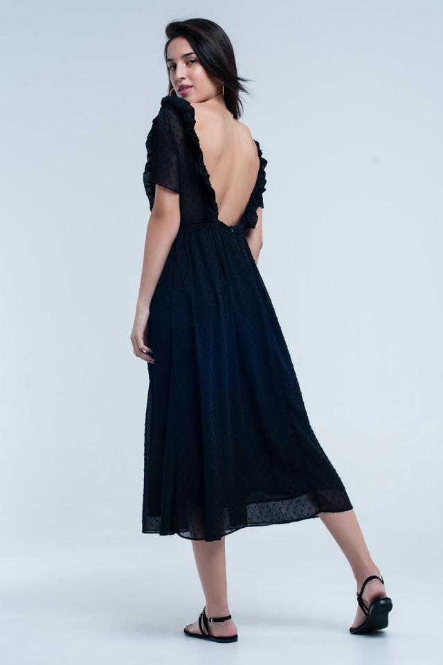 Vestido negro con lunares bordados y detalle volantes