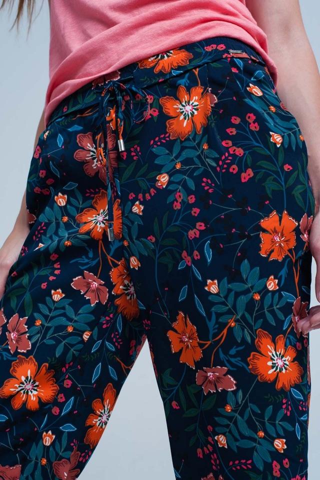 Pantalon con estampado de flores y lazo en la cintura