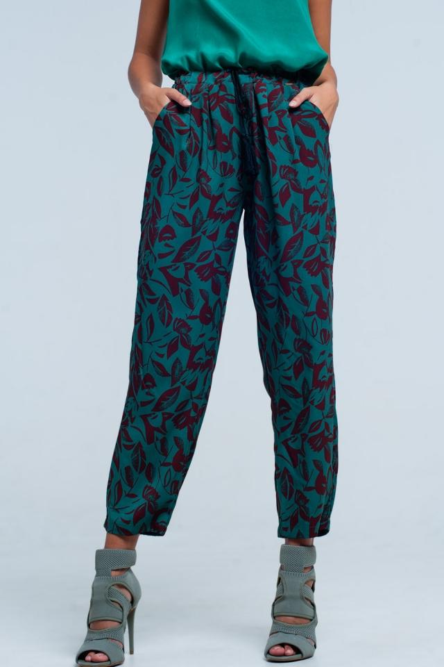 Pantalón de pierna ancha con estampado floral en verde