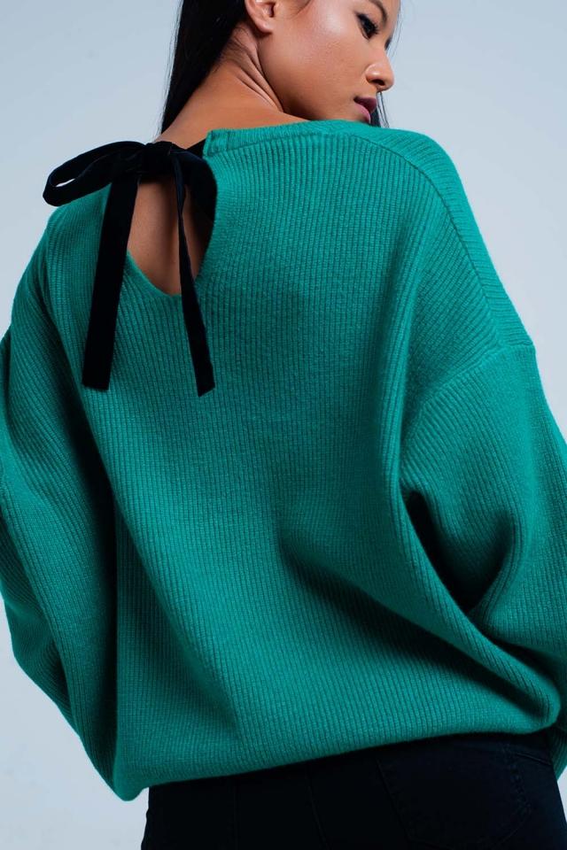 Jersey verde con lazo trasero