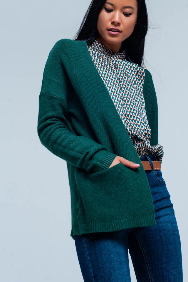 Cárdigan verde con bolsillos