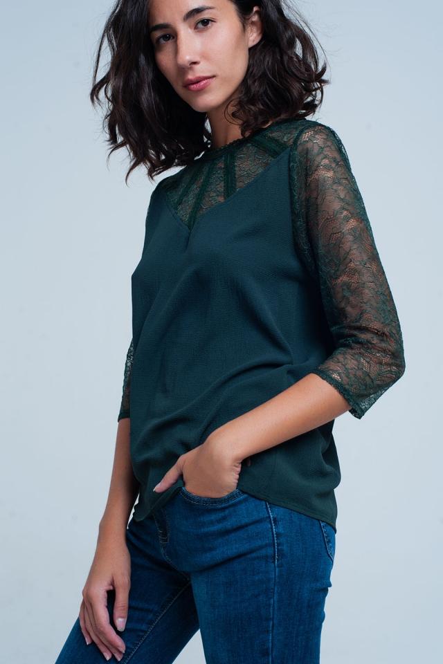 Blusa verde con detalles de encaje
