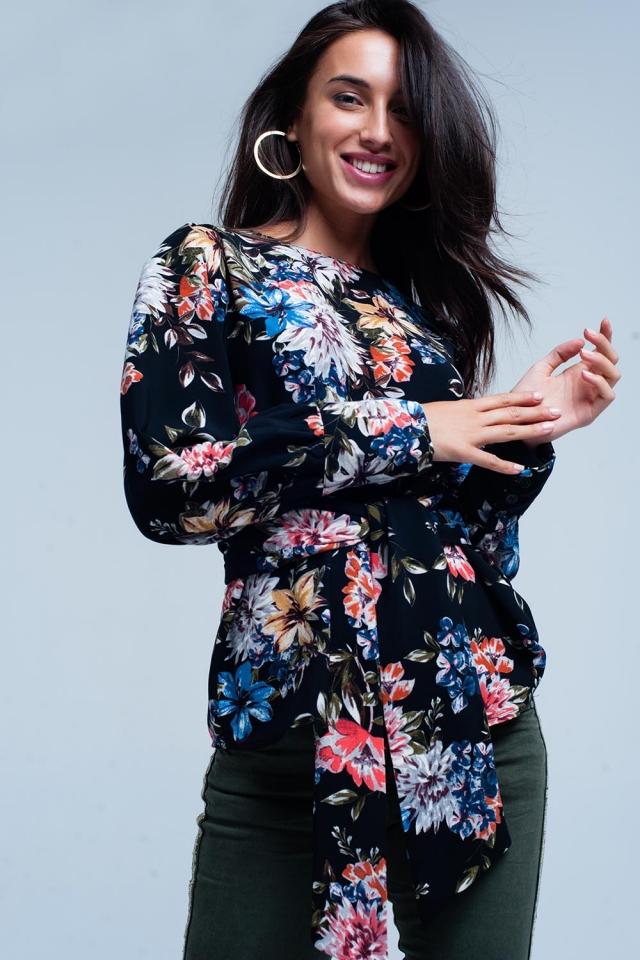 Blusa Negro con estampado floral y lazada en la parte delantera