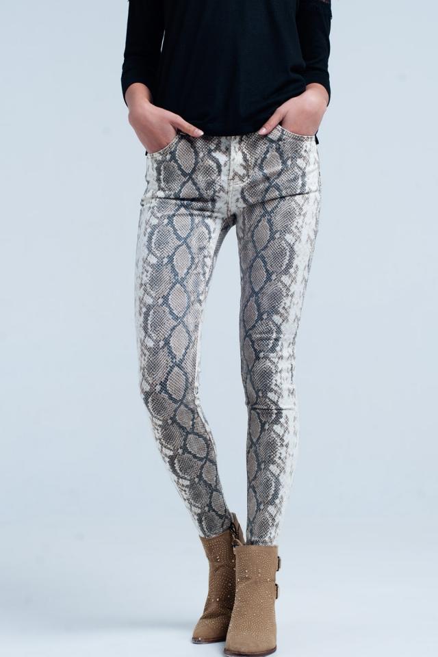 Pantalones pitillo beige en estampado de serpiente
