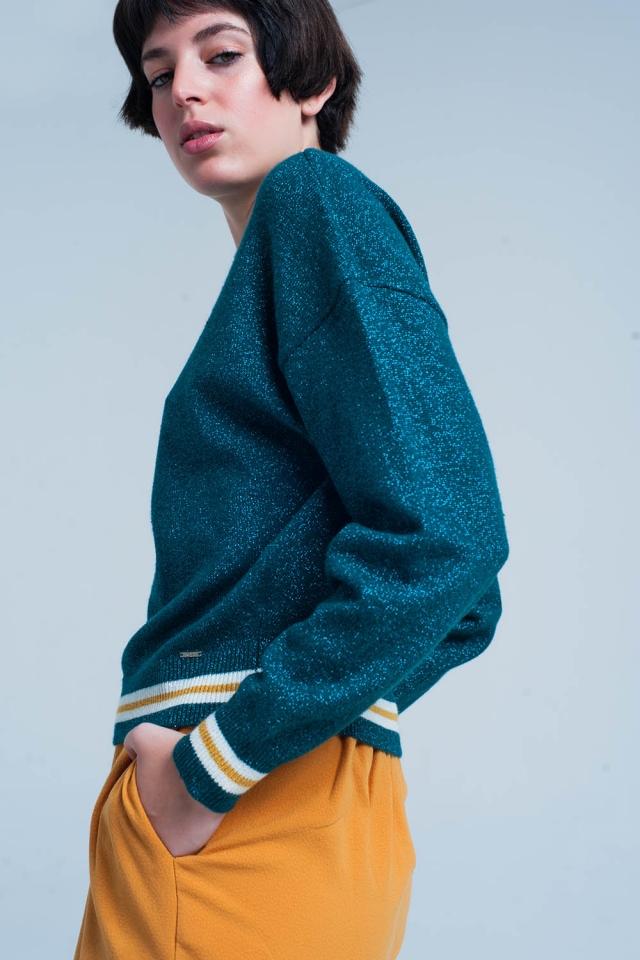 Suéter con purpurina verde y detalles de rayas