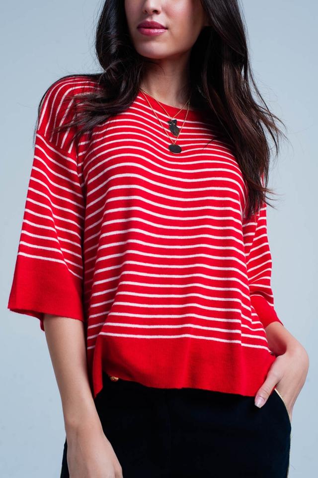 Suéter rojo extragrande de rayas