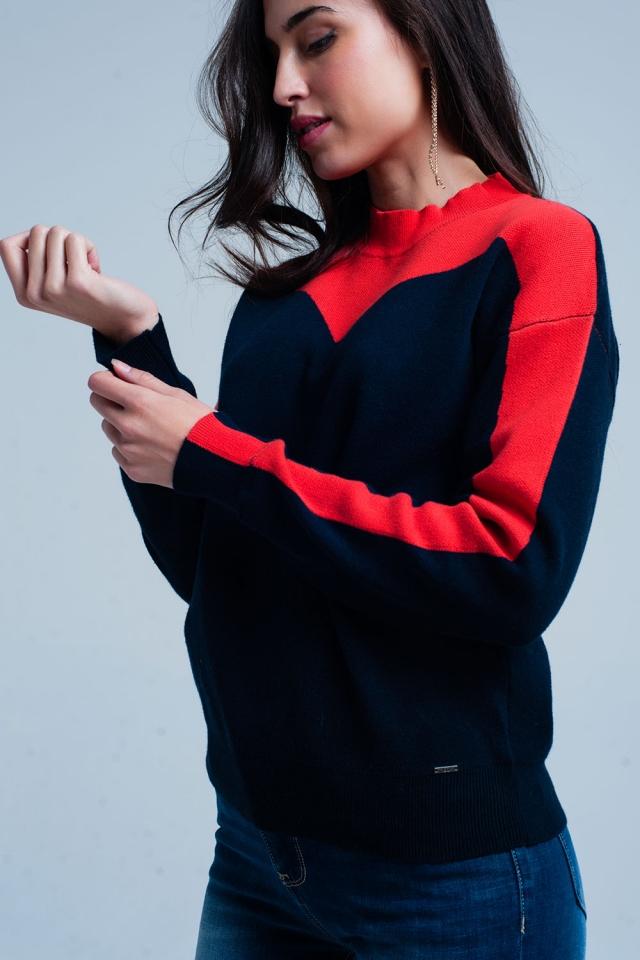 Suéter de cuello alto azul marino y rojo