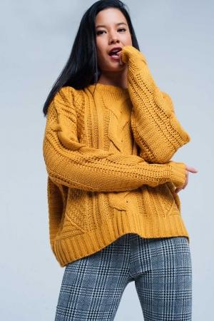 Suéter de punto de ochos mostaza con cuello redondo