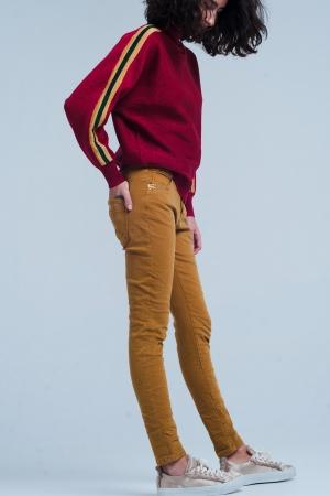 Pantalones mostaza con lentejuelas y botones
