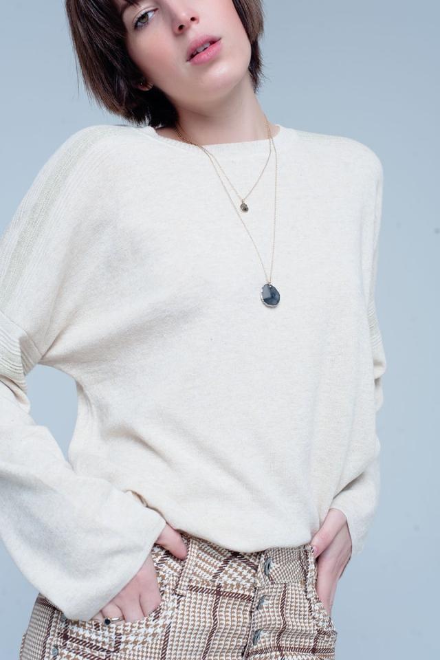 Suéter de punto fino beige con detalles de purpurina