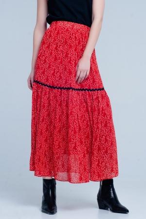 Falda roja midi plisada con estampado de lunares