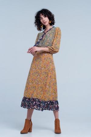Vestido midi color mostaza con lazada en el cuello y estampado combinado