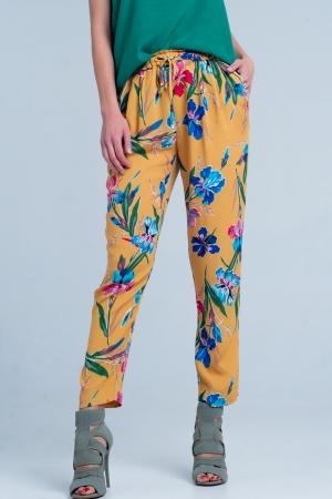 Pantalón con estampado de flores color mostaza