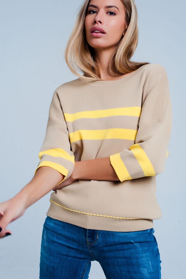 Jersey beige con ribetes y diseño a rayas en contraste