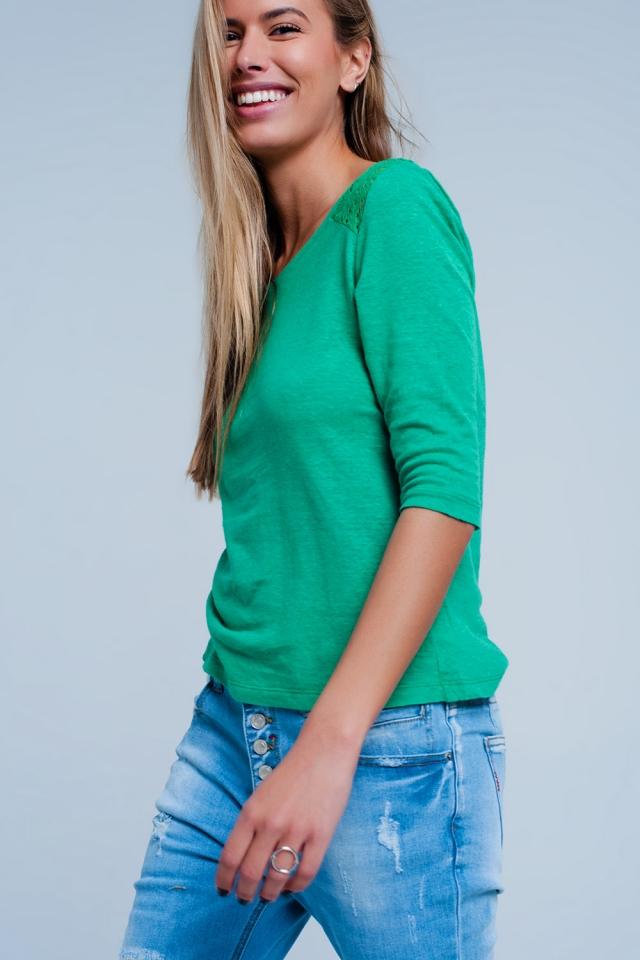 Top Verde liso con mangas 3/4 y aplicación de croché