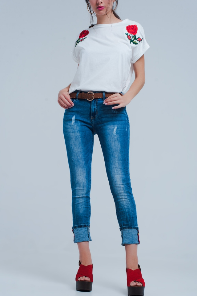 Jeans with distressed detail in mid wash