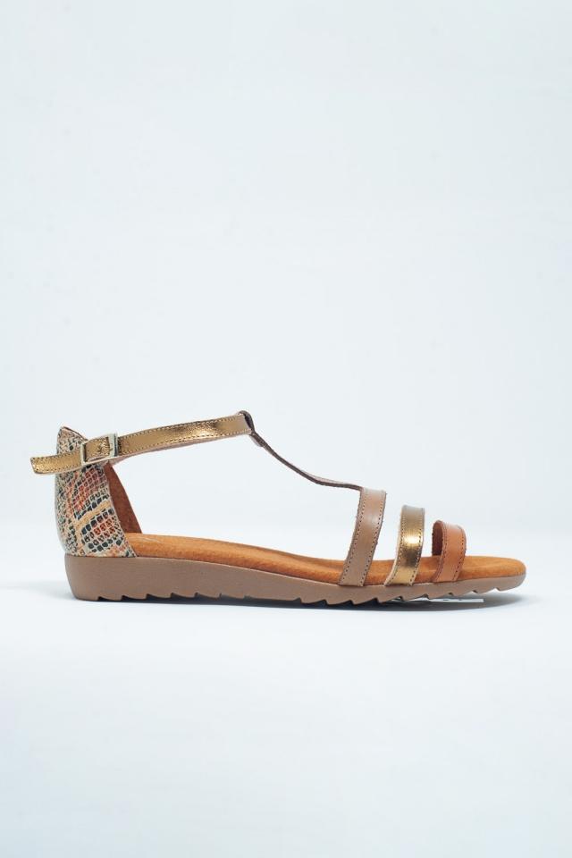 Sandalias planas con correa cruzada de cuero color beige