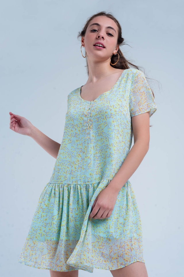 Vestido verde estampado con falda plisada